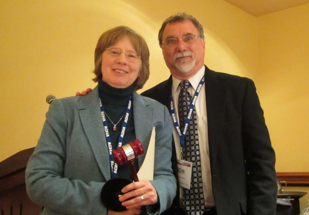 Changing of the Guard: Incoming president Daniel Bornstein presents outgoing president Maggie McGuinness, with a ceremonial gavel during the 2014 Presidential Luncheon held at the Marriott Hotel in Washington, D.C., January 4.